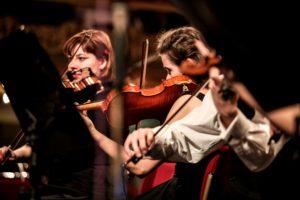 women playing violins